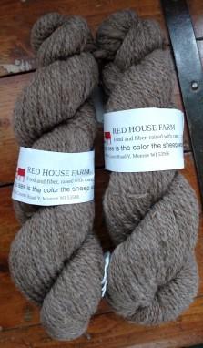 two skeins of brown wool