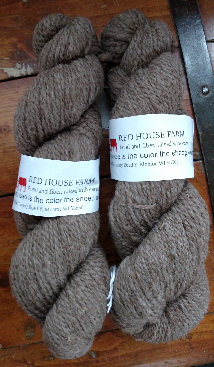 two skeins of brown wool