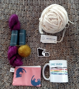 photo of yarn, notions bag, sticker and mug